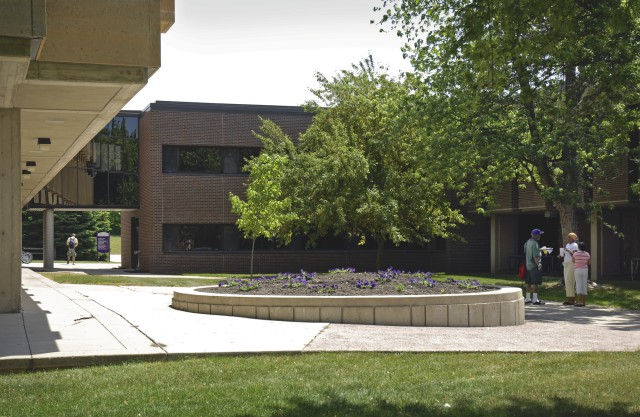 Armstrong and Morris Hall with students