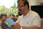 Dr. Habib reading a thank-you card