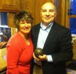 Mark and Jennifer Gibson in 2013, with the shot put that gave them a reason to meet 30 years ago.