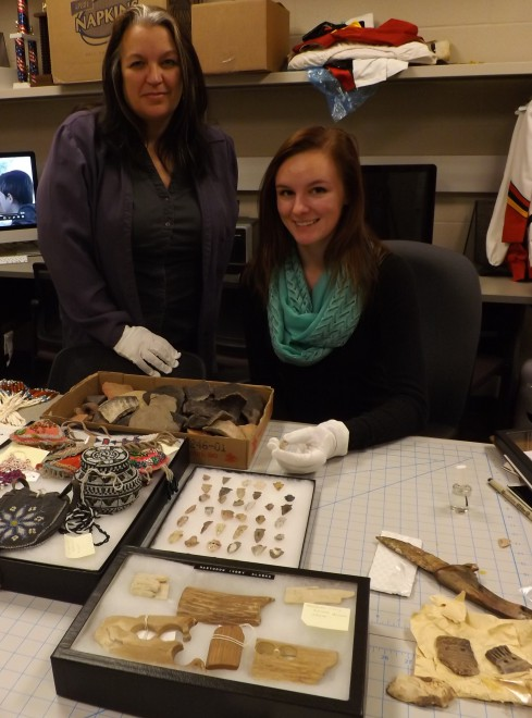 Dr. Rhonda Dass and student Stephanie Dixon with items from Erma Erikson's collection..