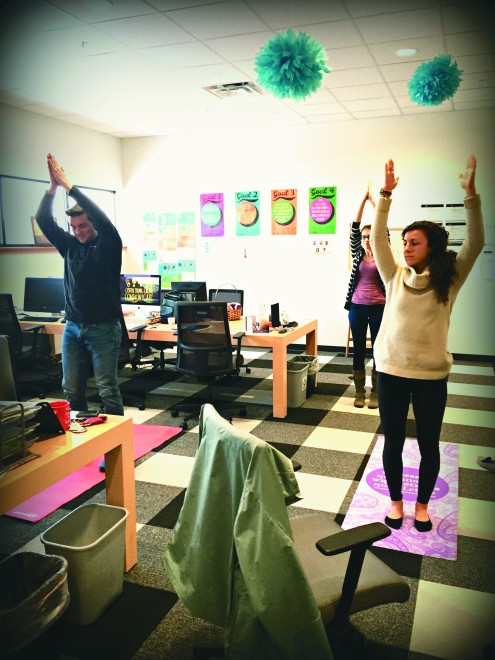 Innovation Architects at the Innovation Center take a break to practice yoga.