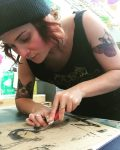 Artist Dana Sikkila working on a linoleum print